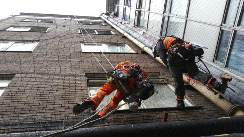 Rope access team installing netting